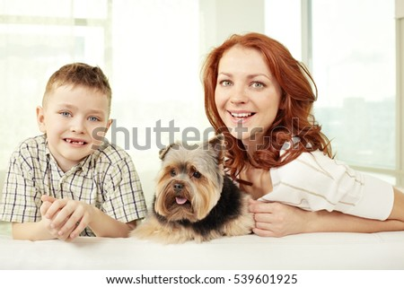 Young woman with her son and a dog