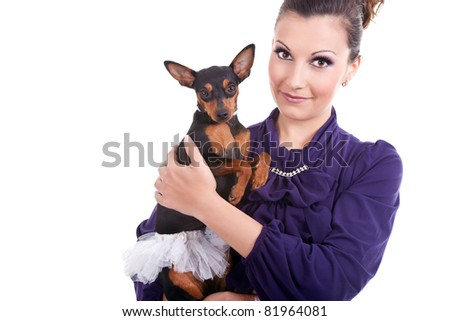 young woman with her trendy puppy, isolated on white background - stock photo