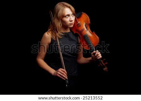 Young woman with her violin - stock photo