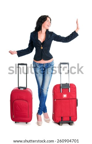 Young Woman with huge luggage hitchhiking while going on vacations - stock photo