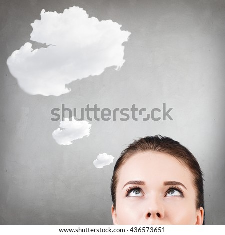 Young woman with idea cloud