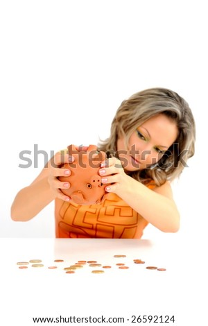 young woman with in piggy bank against white - stock photo
