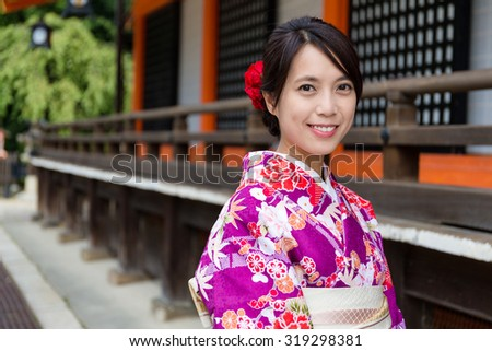 Young woman with Kimono in Temple - stock photo