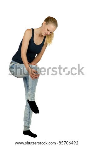 Young woman with knee injury on white background - stock photo