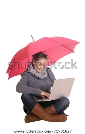 young woman with laptop and umbrella - stock photo