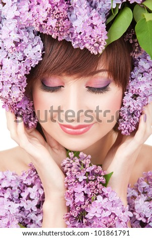 Young woman with lilac flowers