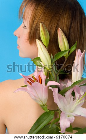 young woman with lily on blue background