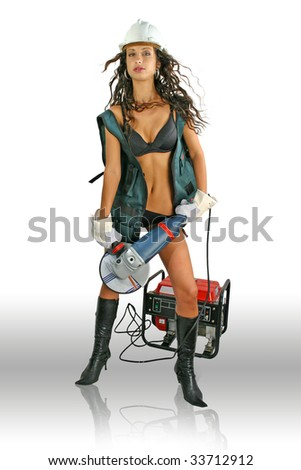 Young woman with lingerie, helmet and gloves. Woman have grinder in there hands plug in generator. - stock photo