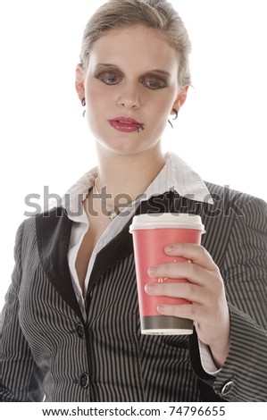 Young woman with lip piercing in a gray business suit and holding a paper coffee cup, isolated on a white background - stock photo