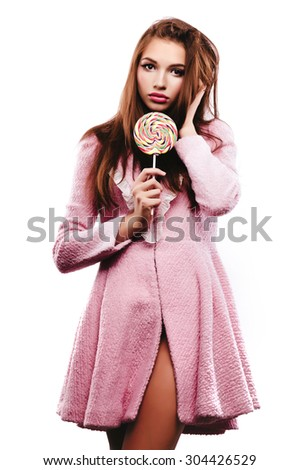 young woman with lollipop candy isolated on white - stock photo