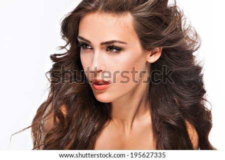 young woman with long brown hair, beauty portrait, studio shot - stock photo