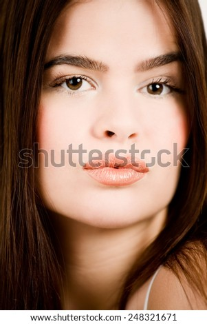 Young woman with long dark hair. - stock photo