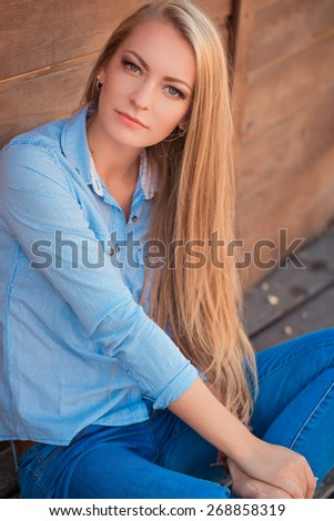 Young woman with long hair - stock photo