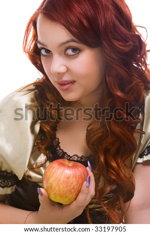 young woman with long hair and apple in hand - stock photo