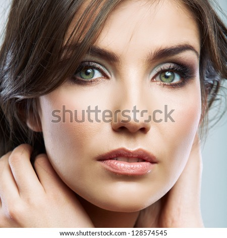 Young woman with long hair. Beauty style studio face portrait isolated - stock photo