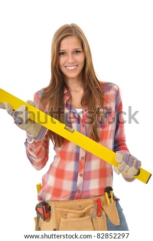 Young woman with long hair holding a spirit level - stock photo