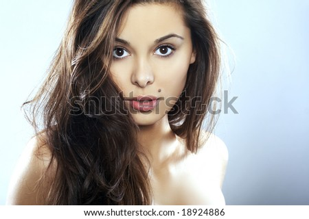Young Woman with long Hair on blue background - stock photo