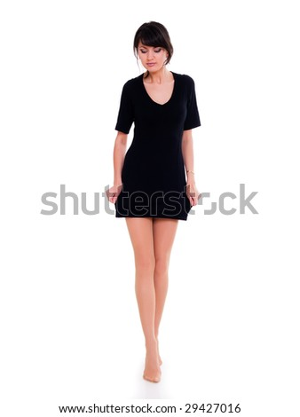 Young woman with long legs on white background