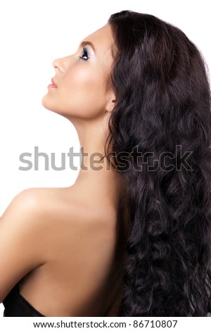 Young woman with long shiny hair isolated - stock photo