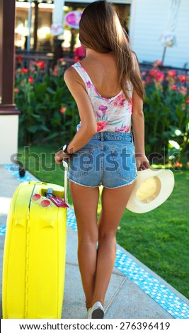 Young woman with luggage at international airport.Happy of her vacation at warm country on holidays,Summer mood,tropical mood,summer trendy clothes,vacation to hot countries,big luggage,sunglasses - stock photo