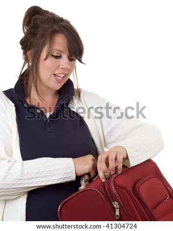 Young woman with luggage; isolated on a white background. - stock photo