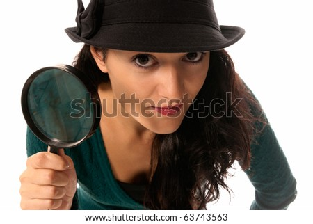 young woman with magnifier glass and hat looking to camera isolated on white background - stock photo