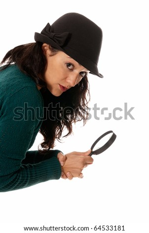 young woman with magnifier glass and hat looking to camera isolated on white background