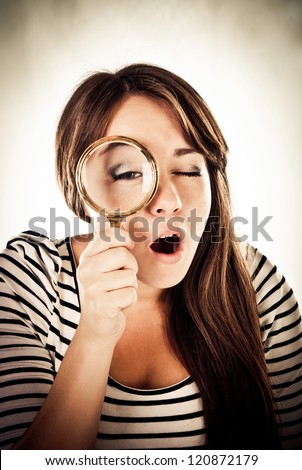 young woman with magnifying glass - stock photo