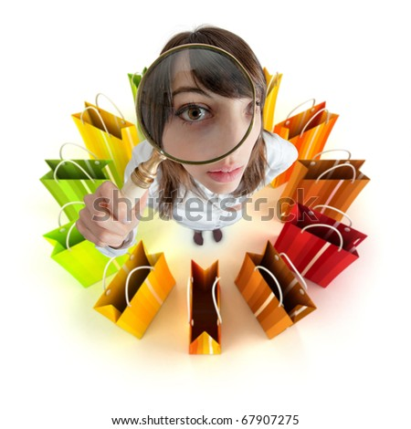Young woman with magnifying glass surrounded by shopping bags