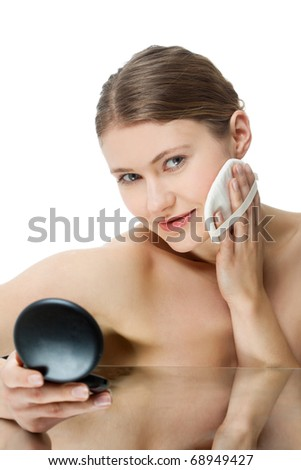 young woman with make-up brush - stock photo