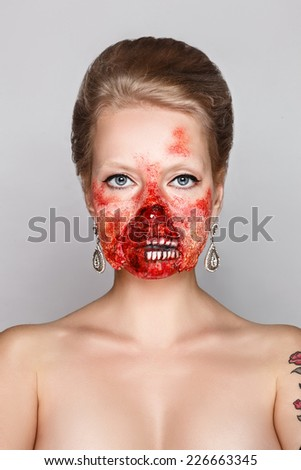 Young woman with make-up zombies on Halloween in the studio  - stock photo