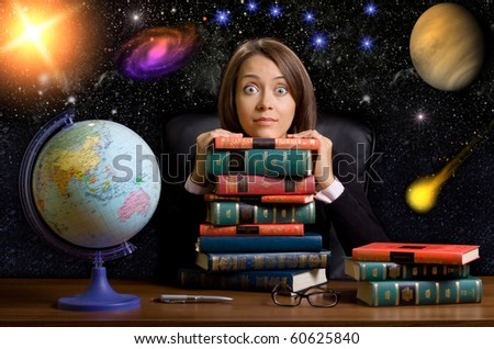 young woman with many books at the desk on space background - stock photo