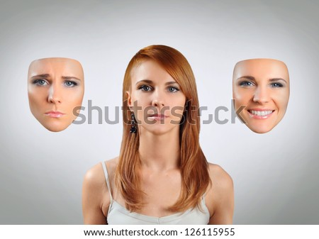 young woman with many faces - stock photo