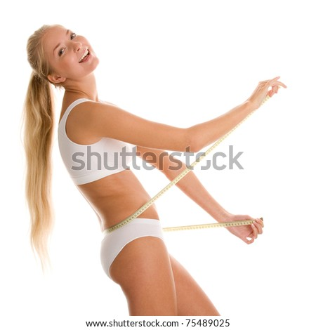 Young woman with measure tape - stock photo