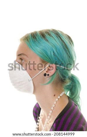 Young woman with medical or air filtration mask on, isolated on white - stock photo