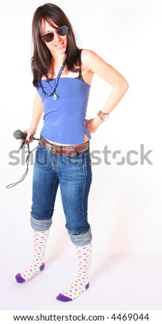Young woman with microphone concept. Popular woman music performer - stock photo