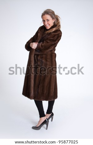 Young woman with mink coat , full portrait - stock photo