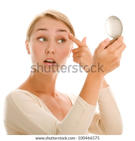 Young woman with mirror - stock photo