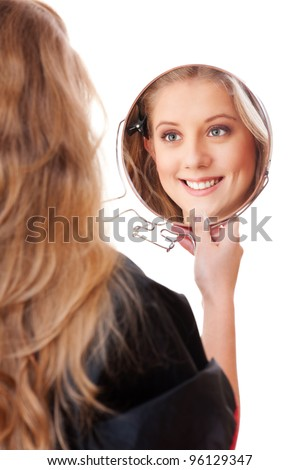 young woman with mirror over white background - stock photo