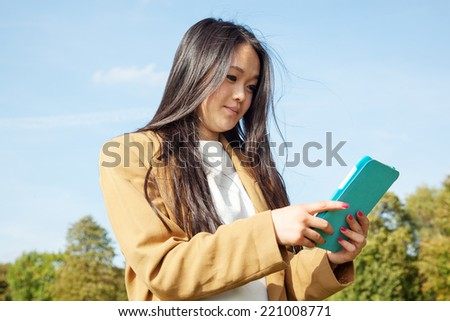 Young woman with mobile tablet PC - stock photo