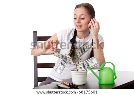 Young woman with money tree on a white background. Concept financial growth.