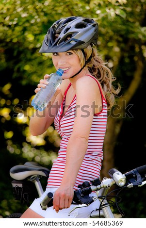 Young woman with mountain bike - stock photo