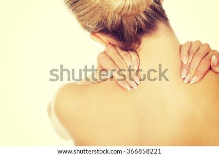 Young woman with nape pain. - stock photo