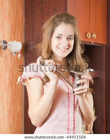 young woman with new tap at her home