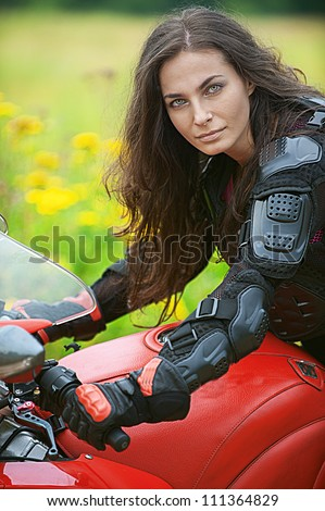 Young woman with nice bike on road. - stock photo