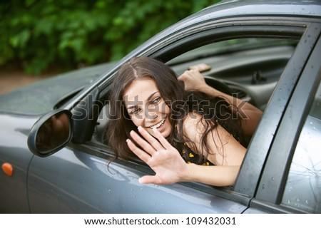 Young woman with nice car on road. - stock photo