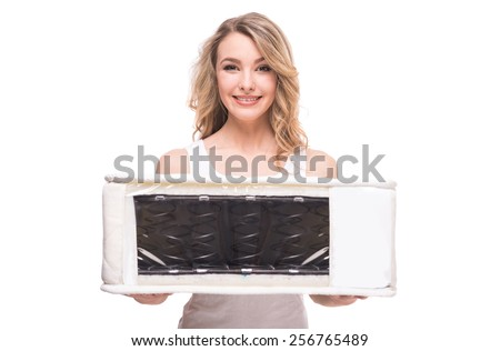 Young woman with nice, quality mattress that supported you to sleep well all night. - stock photo