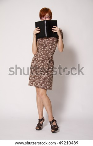 Young Woman with Notebook and Glasses - stock photo