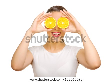 Young woman with orange slices - stock photo