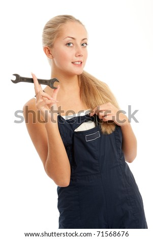 young woman with overalls on, white background - stock photo